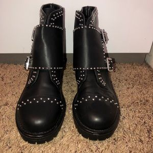 Black leather boots with silver studs.